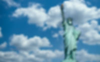 Statue of liberty wearing a surgical mas