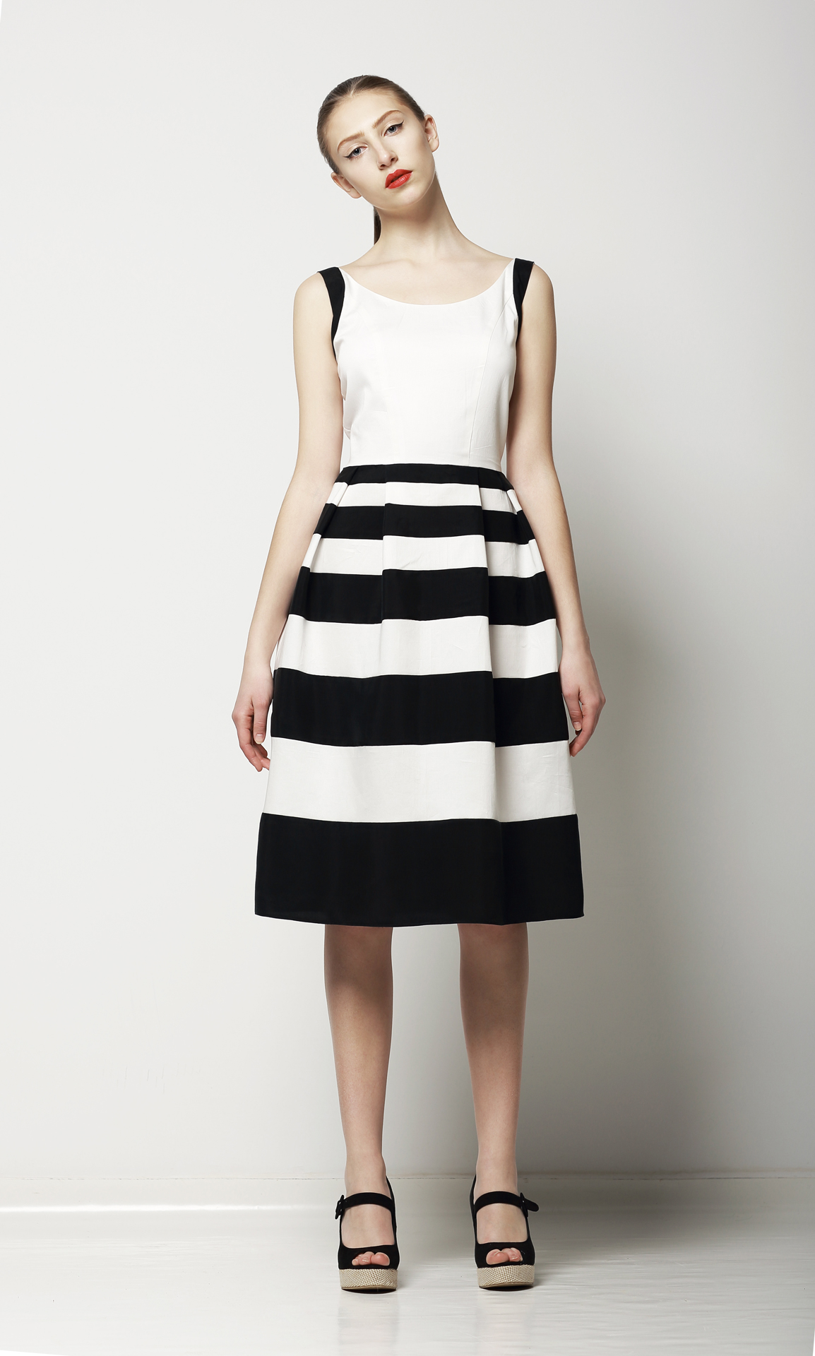 Fashion Model in Monochrome Dress