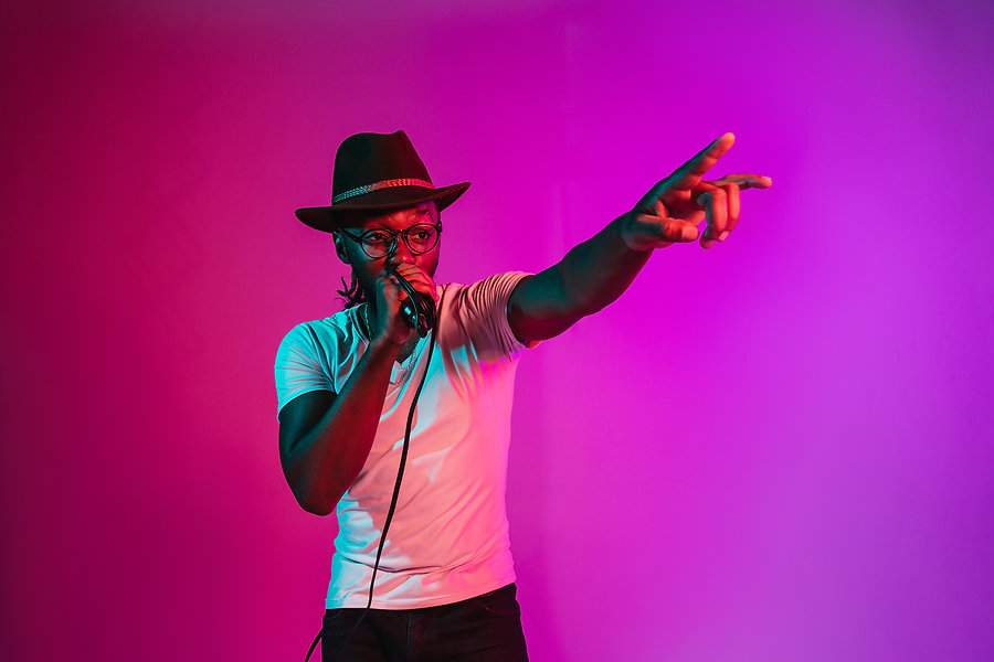 young-african-american-jazz-musician-singing-song-on-gradient-pink.jpg
