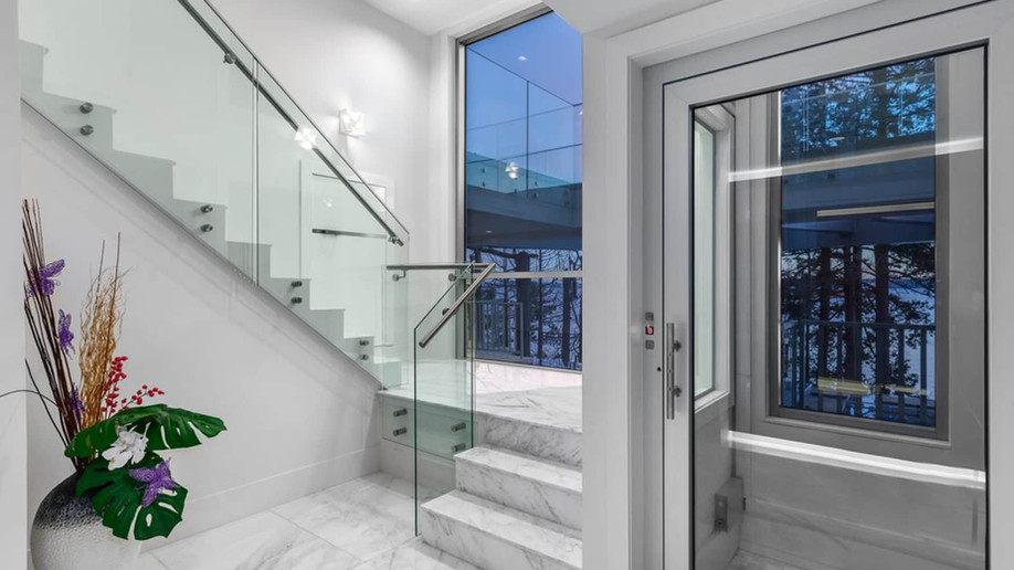 An edgy, stunning new home boasts  a three-storey glass elevator