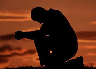 Prayingmanknealing.jpg