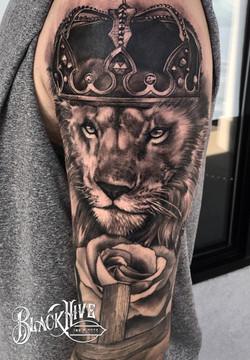 lion tattoo black and grey tattoo