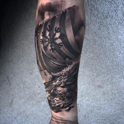 viking ship black and grey tattoo