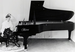 Jean with her Kawai EX Concert Grand