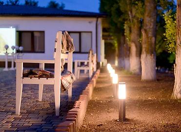 Row of Illuminated Outdoor Lights in Gro