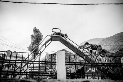 Kids playing on slide in India
