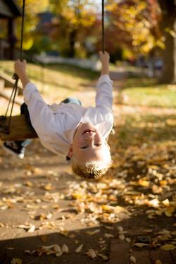 Boy on swing in fall