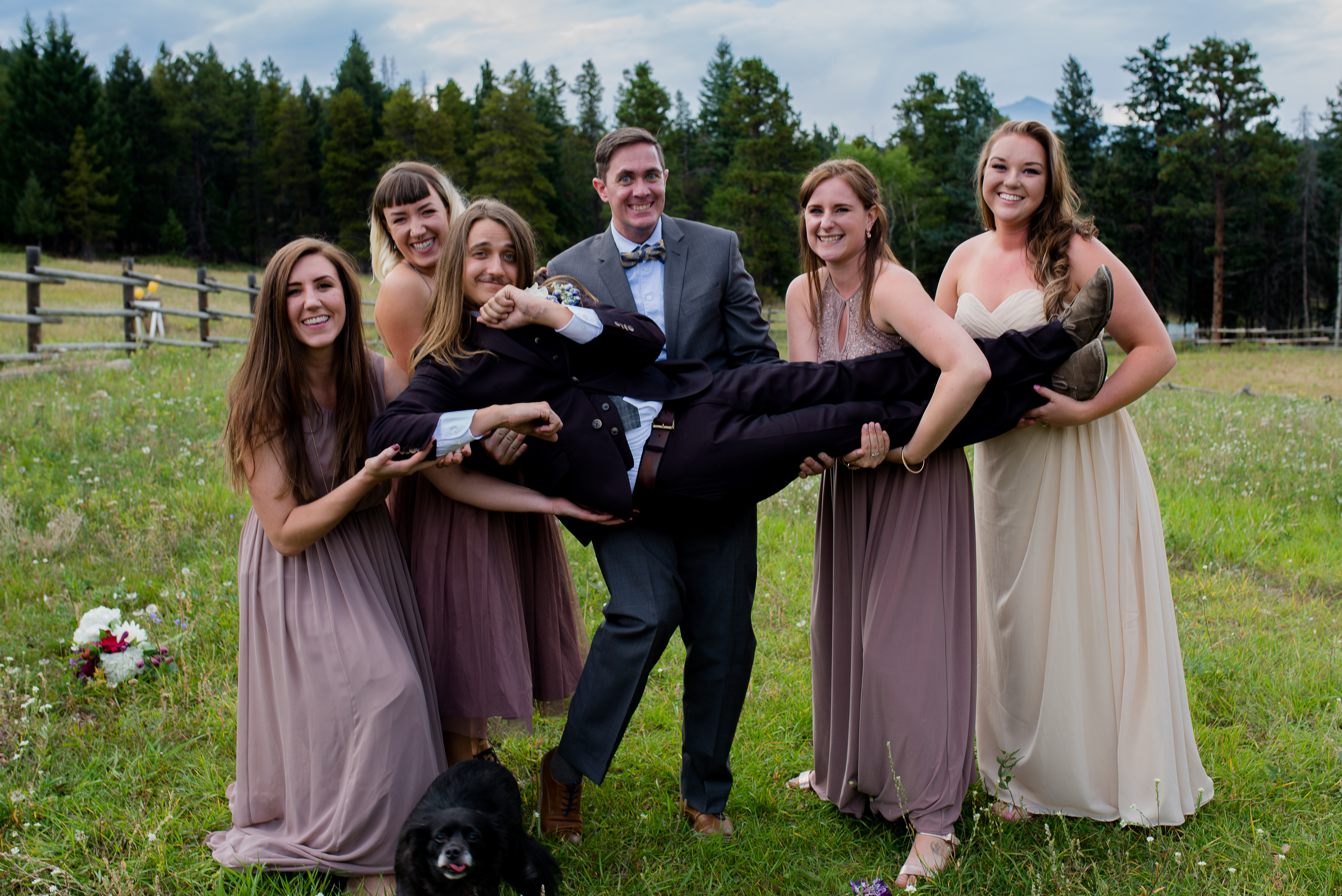 The bridesmaids carrying the groom
