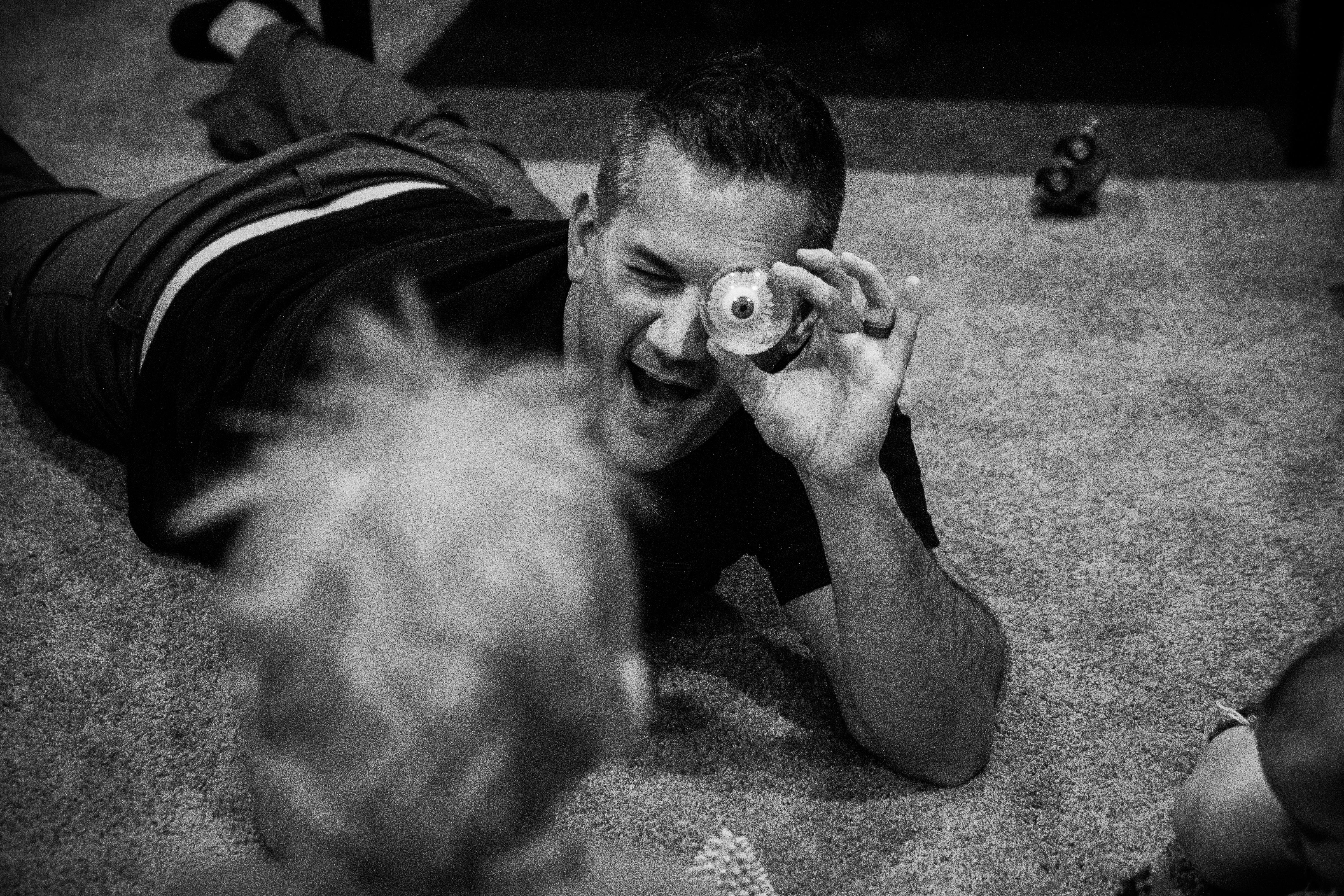 Dad looks at toddler with fake eye