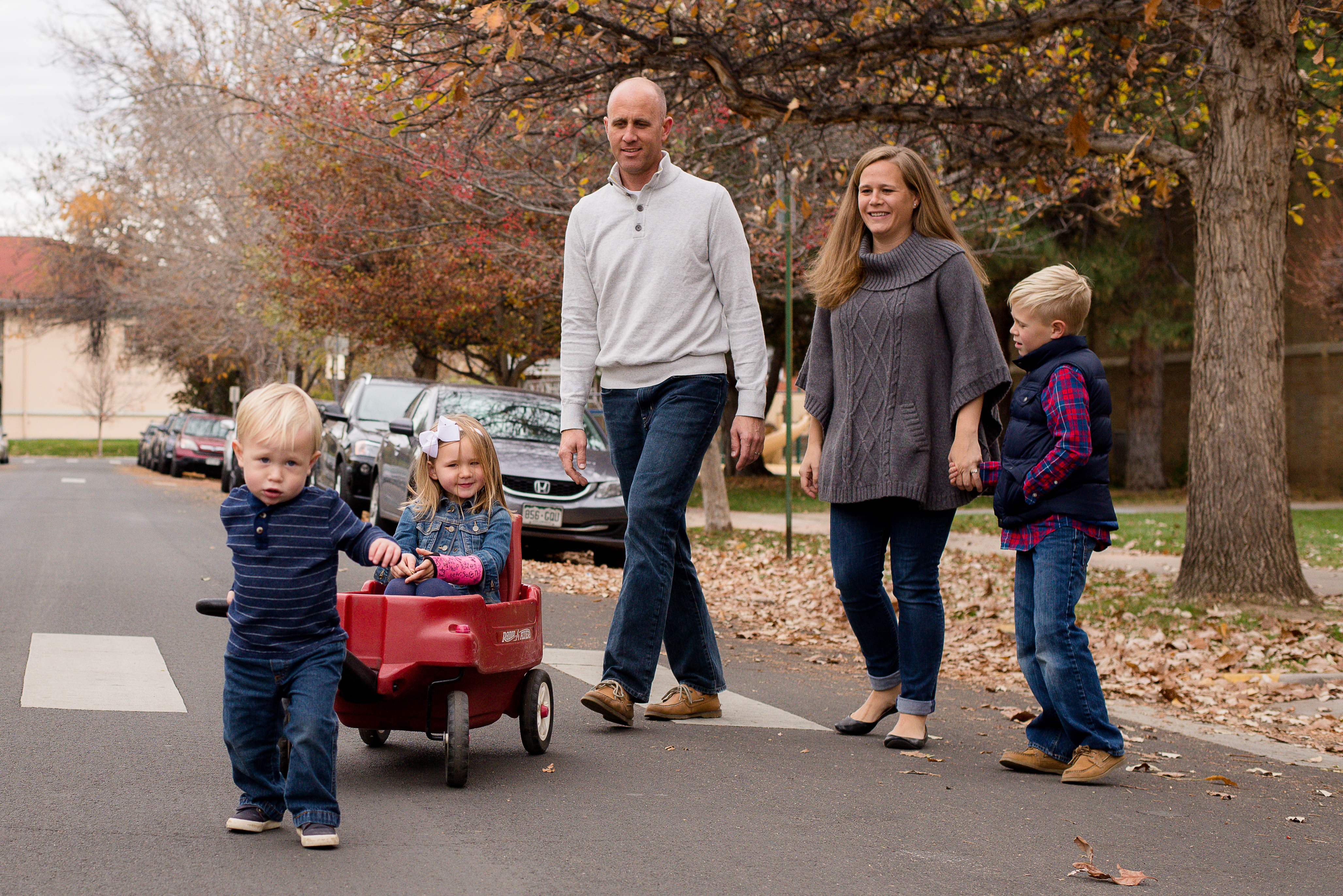 Family of 5 walking across street