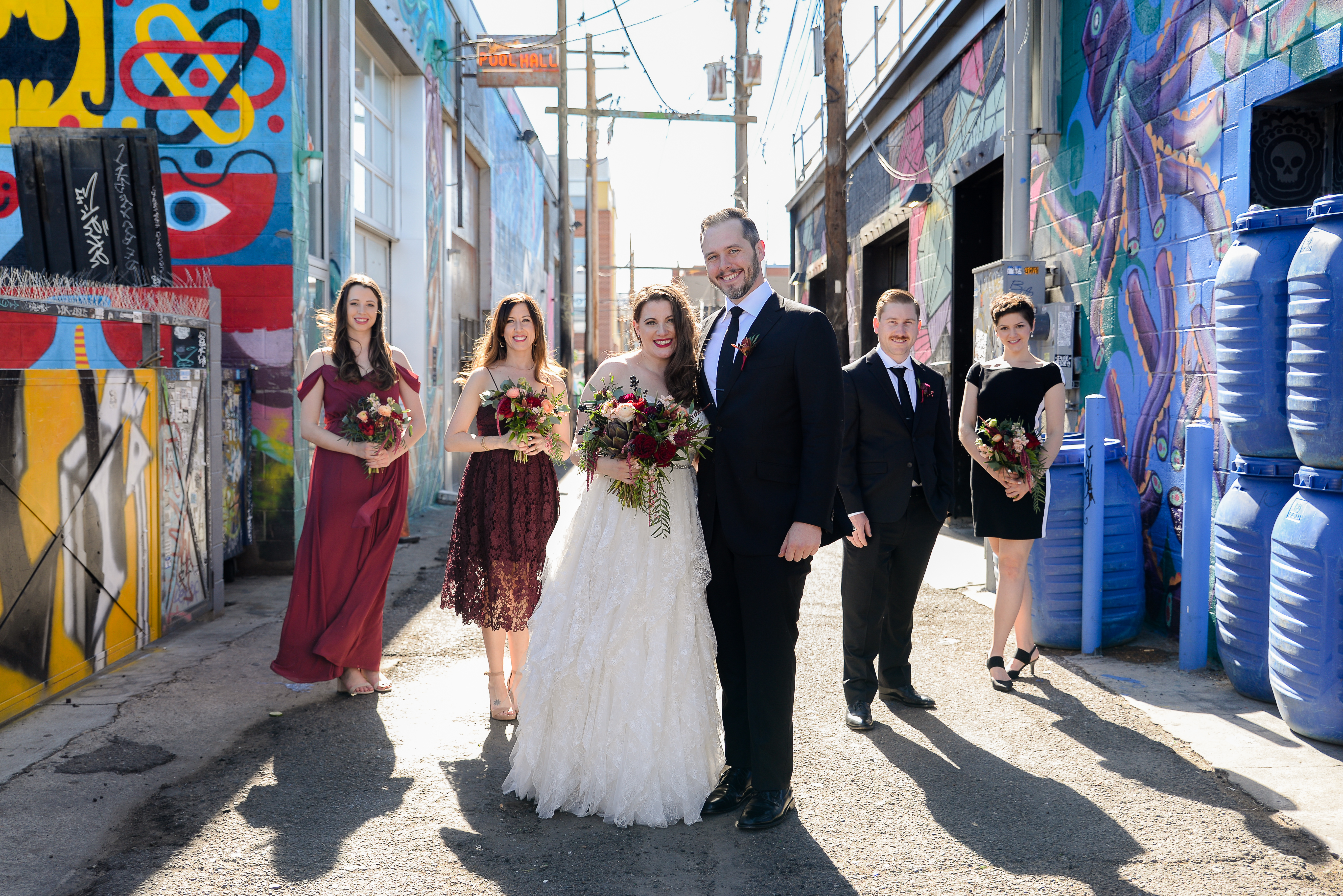 Bridal party in graffiti alley