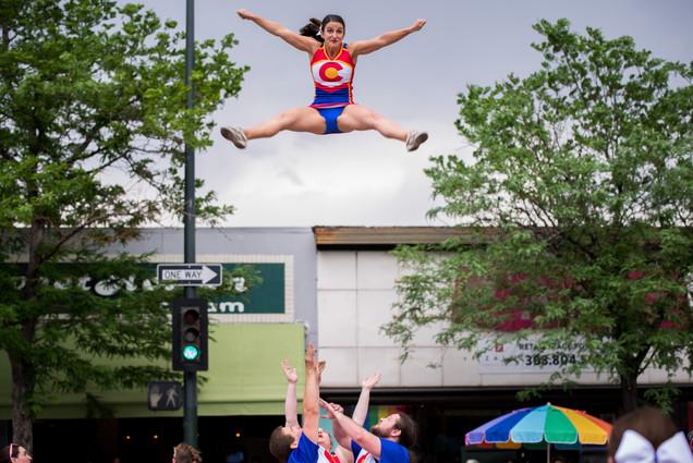 Colorado Cheer team does split jump over South Broadway Denver