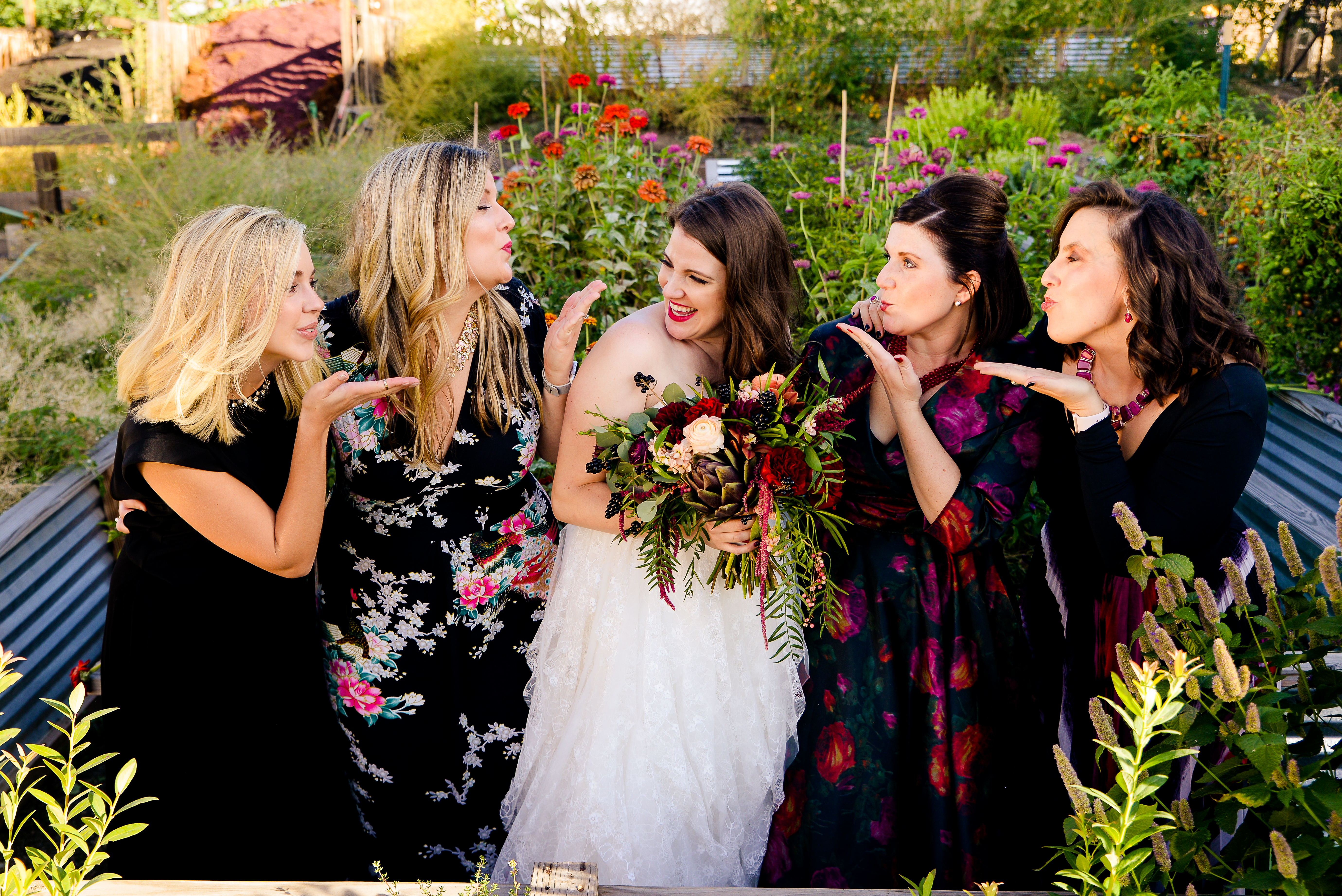 Bridesmaids blowing kisses to bride
