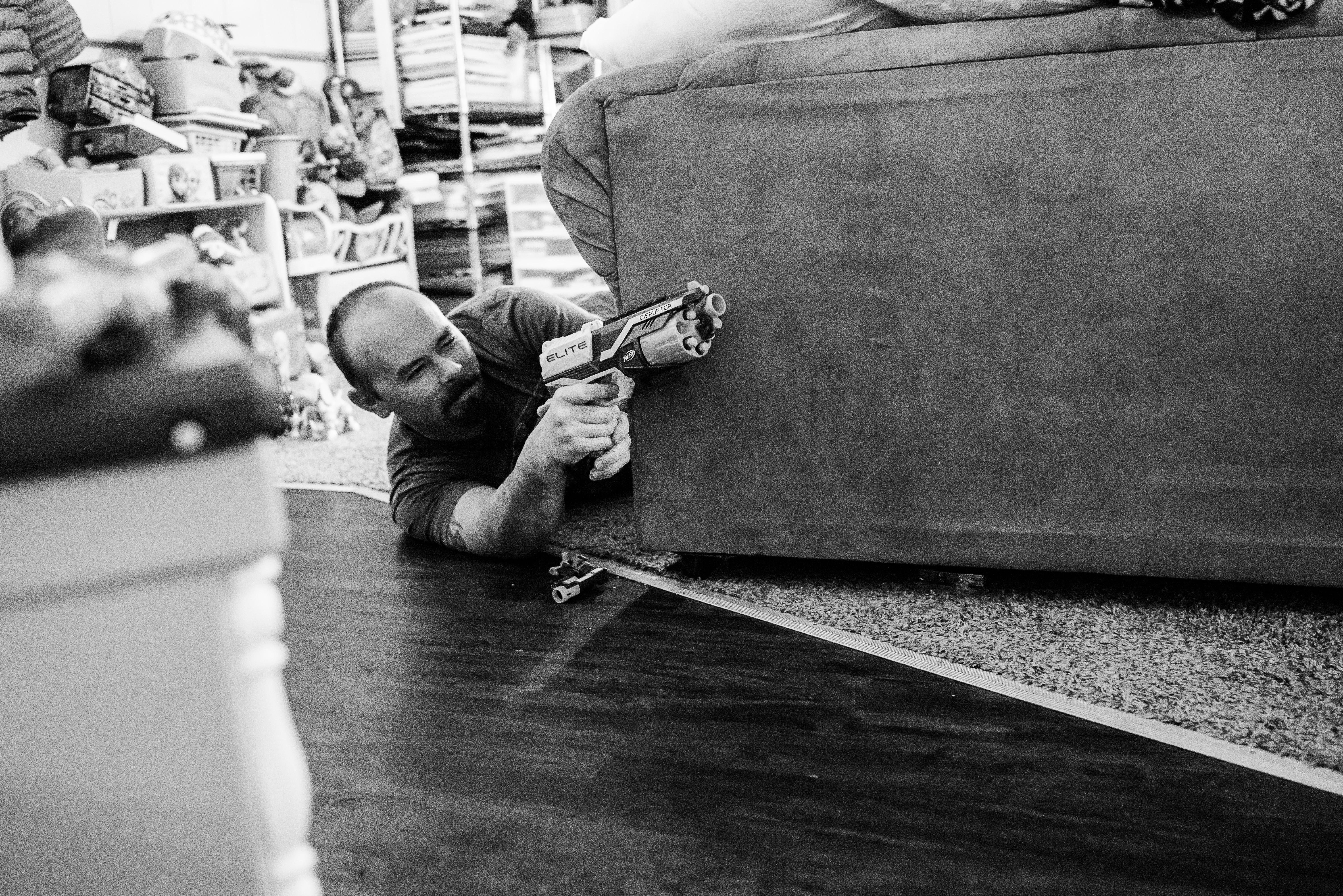 Man shooting nerf gun