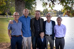 Adult brothers and dad by lake