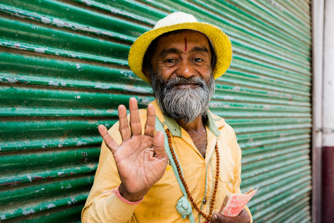 Portrait of little Indian Man in yellow on green
