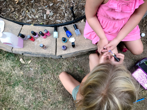 Girls painting each others' nails
