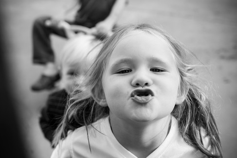 Little girl making kissy face
