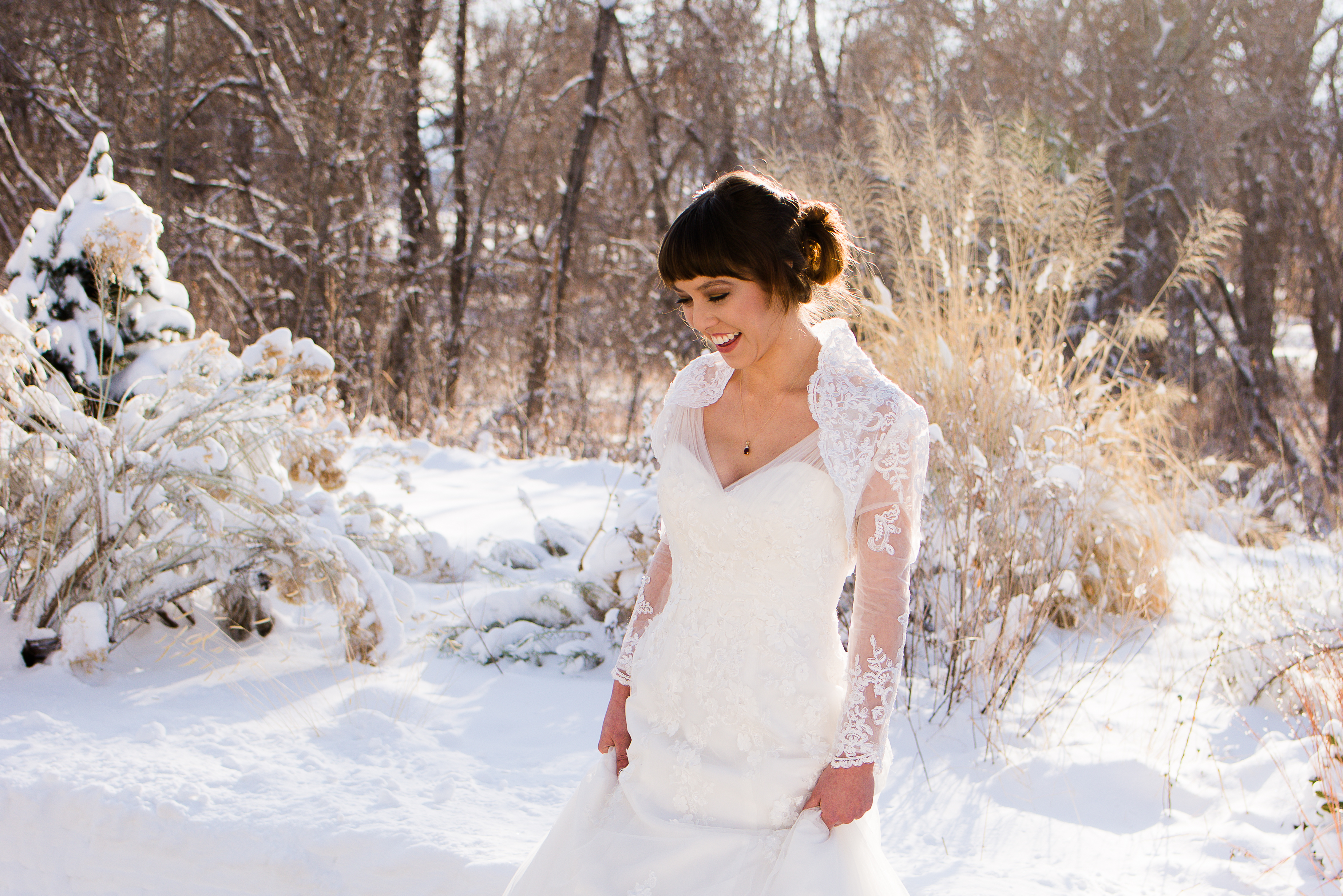 Bride in winter with golden sun