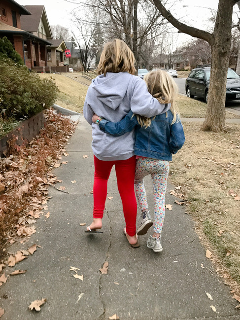 Sisters walking together in fall