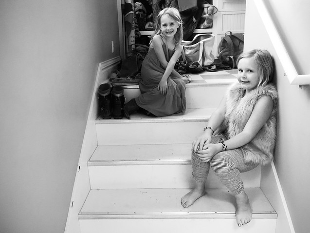 Sisters sitting on stairs