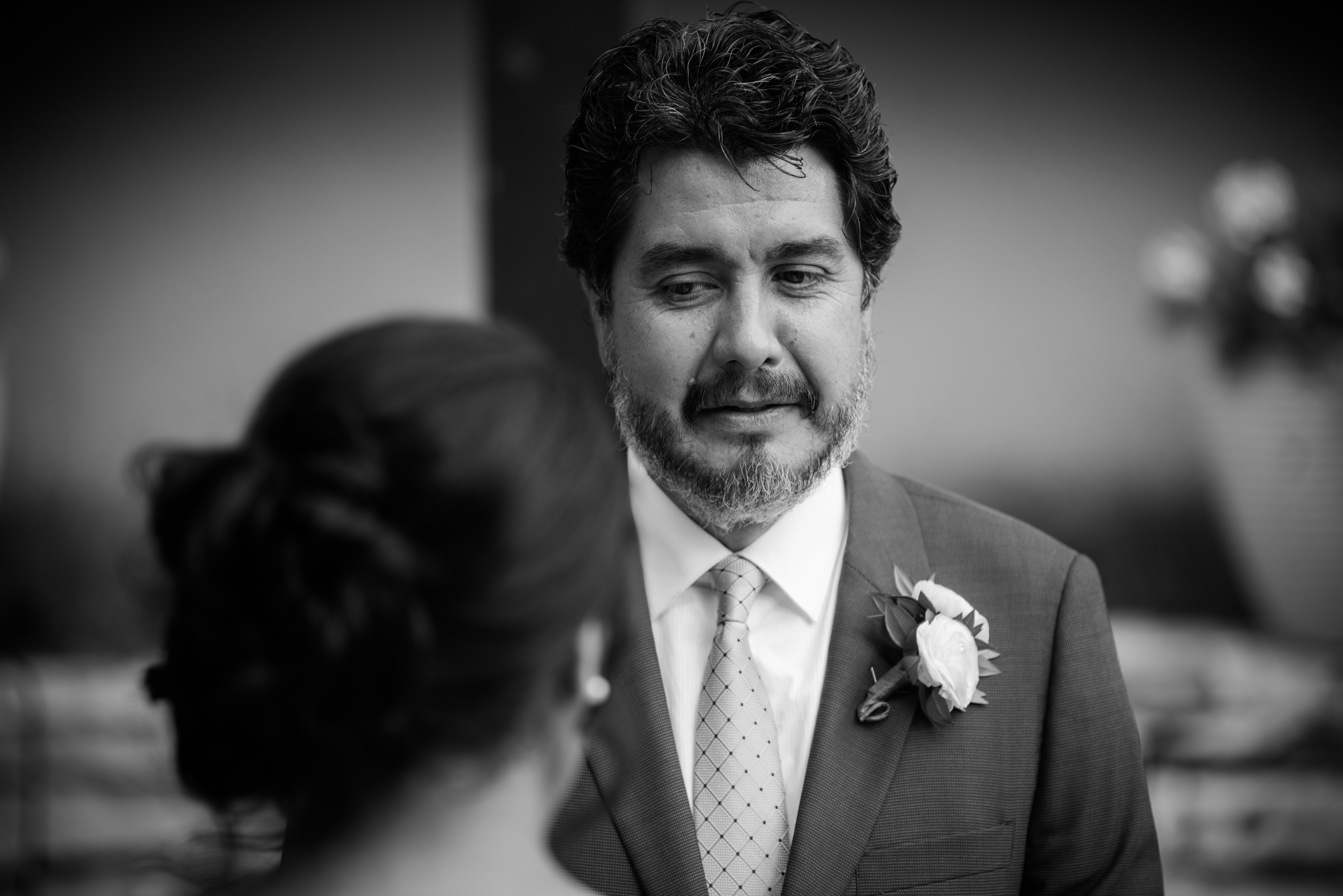 Groom looking emotional at bride