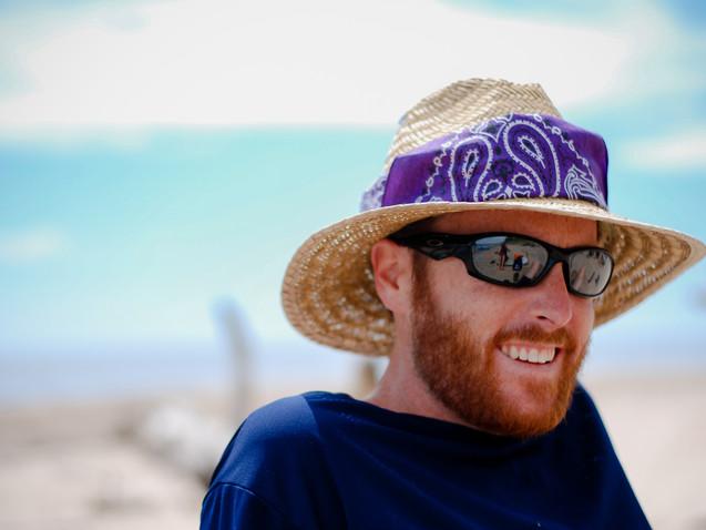 Man with straw hat on beach