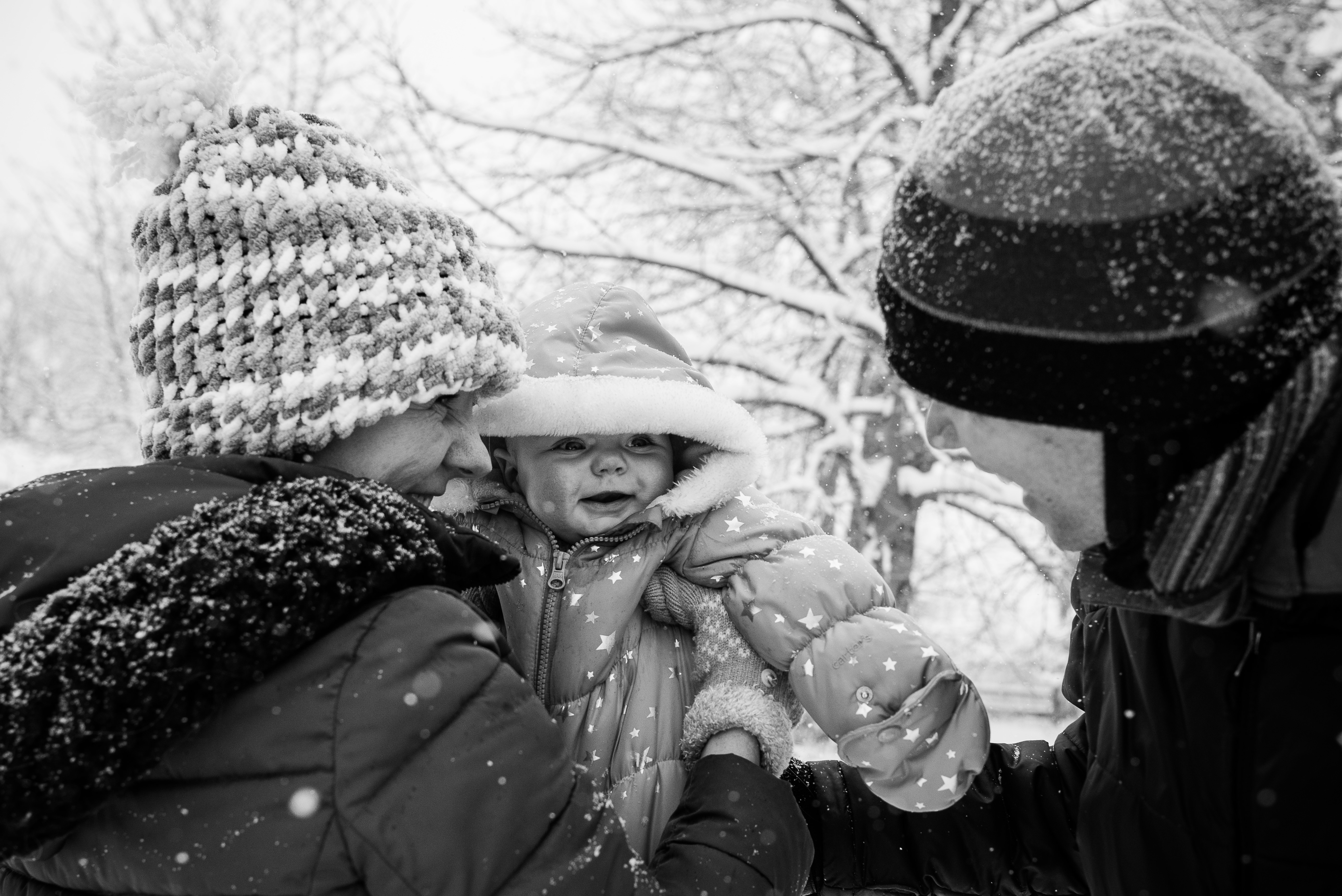 Mom, dad, and baby in snow
