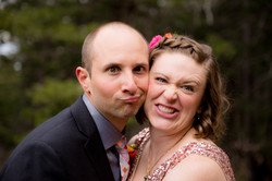 Bride and groom making funny faces