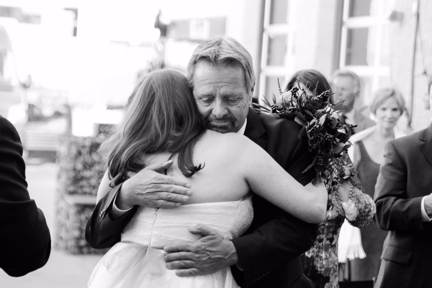 Dad hugging bride at wedding