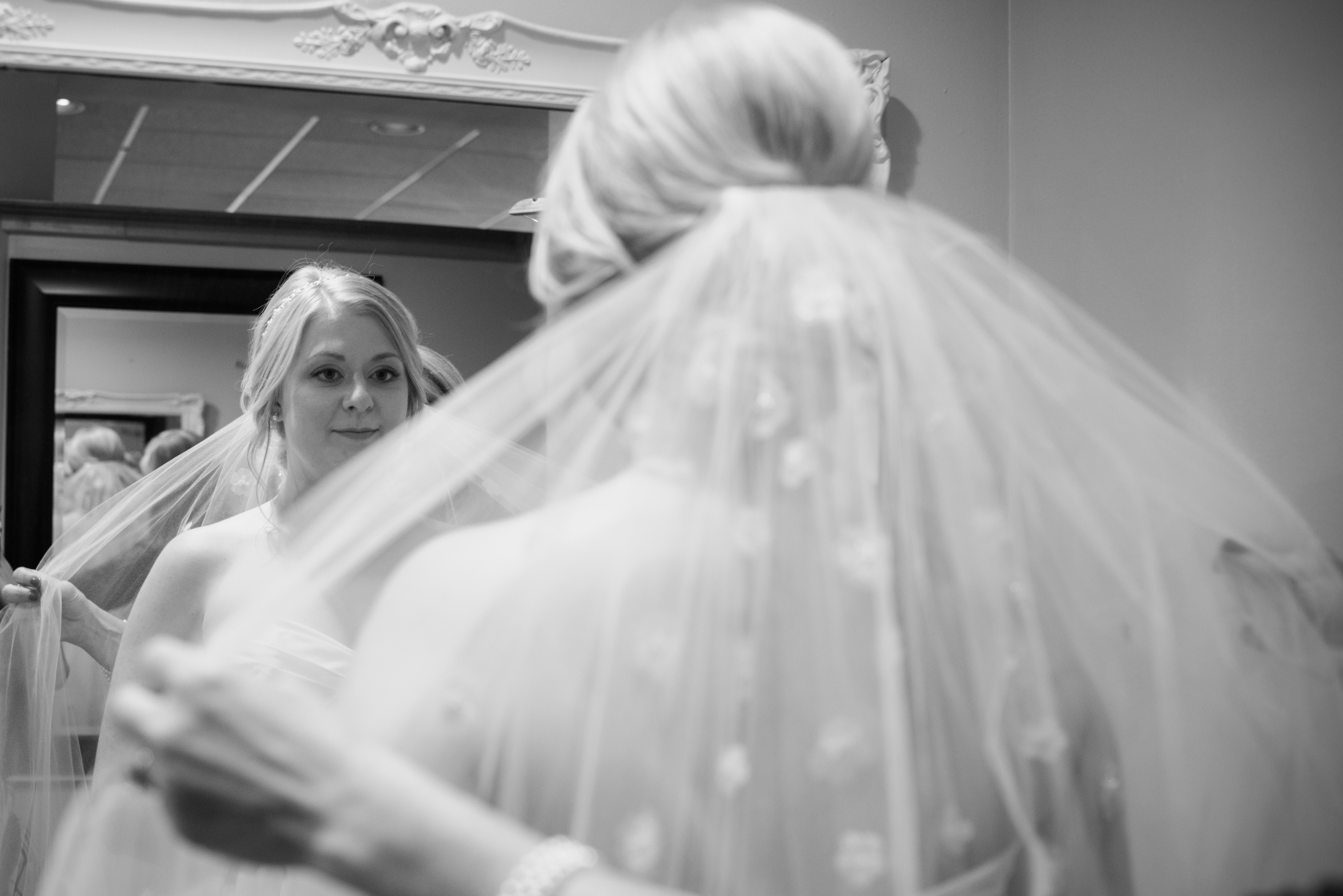 Bride sees herself in mirror