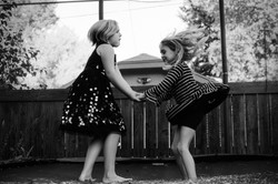 Young sisters jump on trampoline