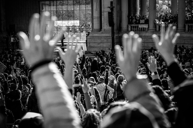 Victims raise their hands at women's march
