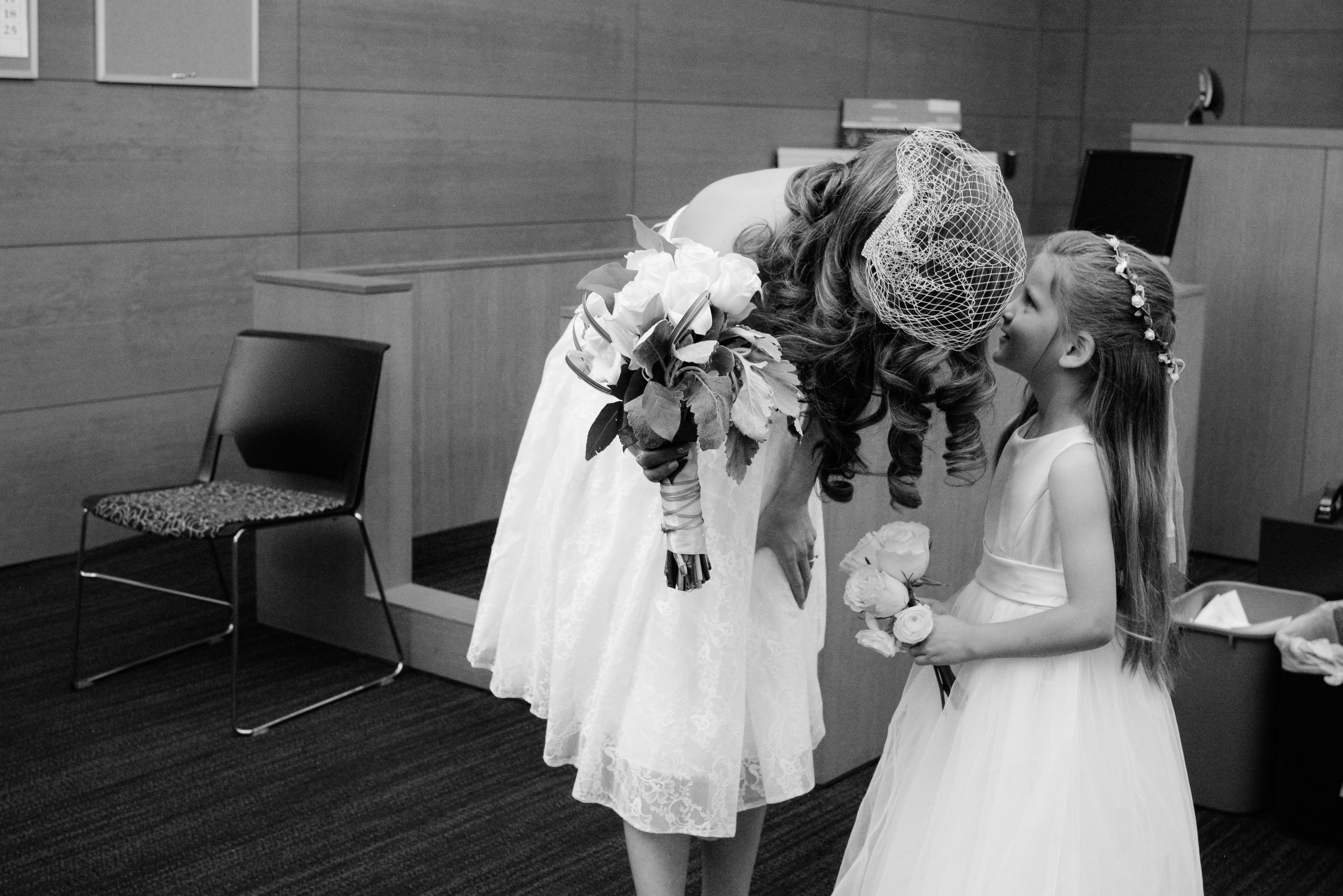 Bride whispering to her little girl