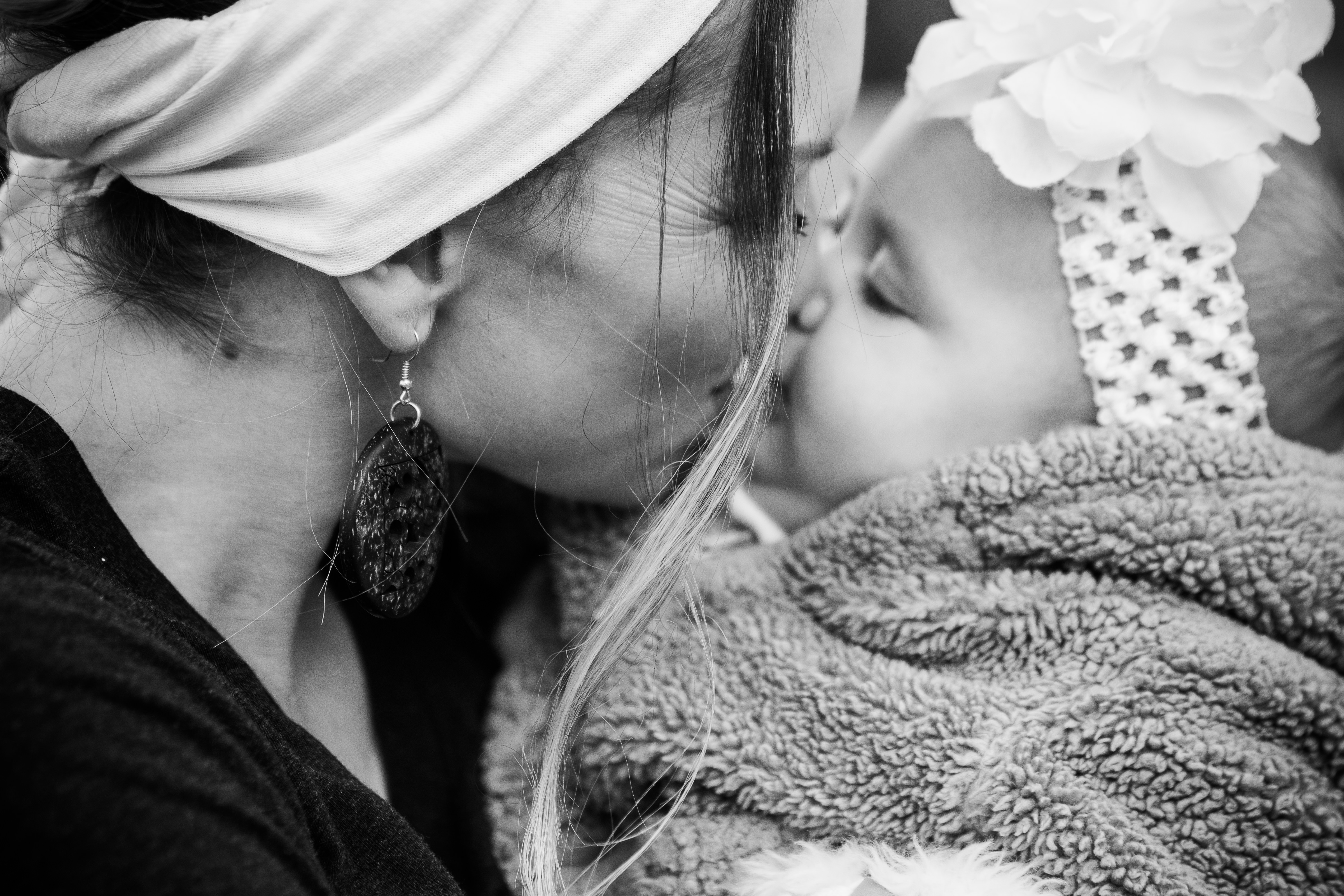 Mom kissing baby closeup