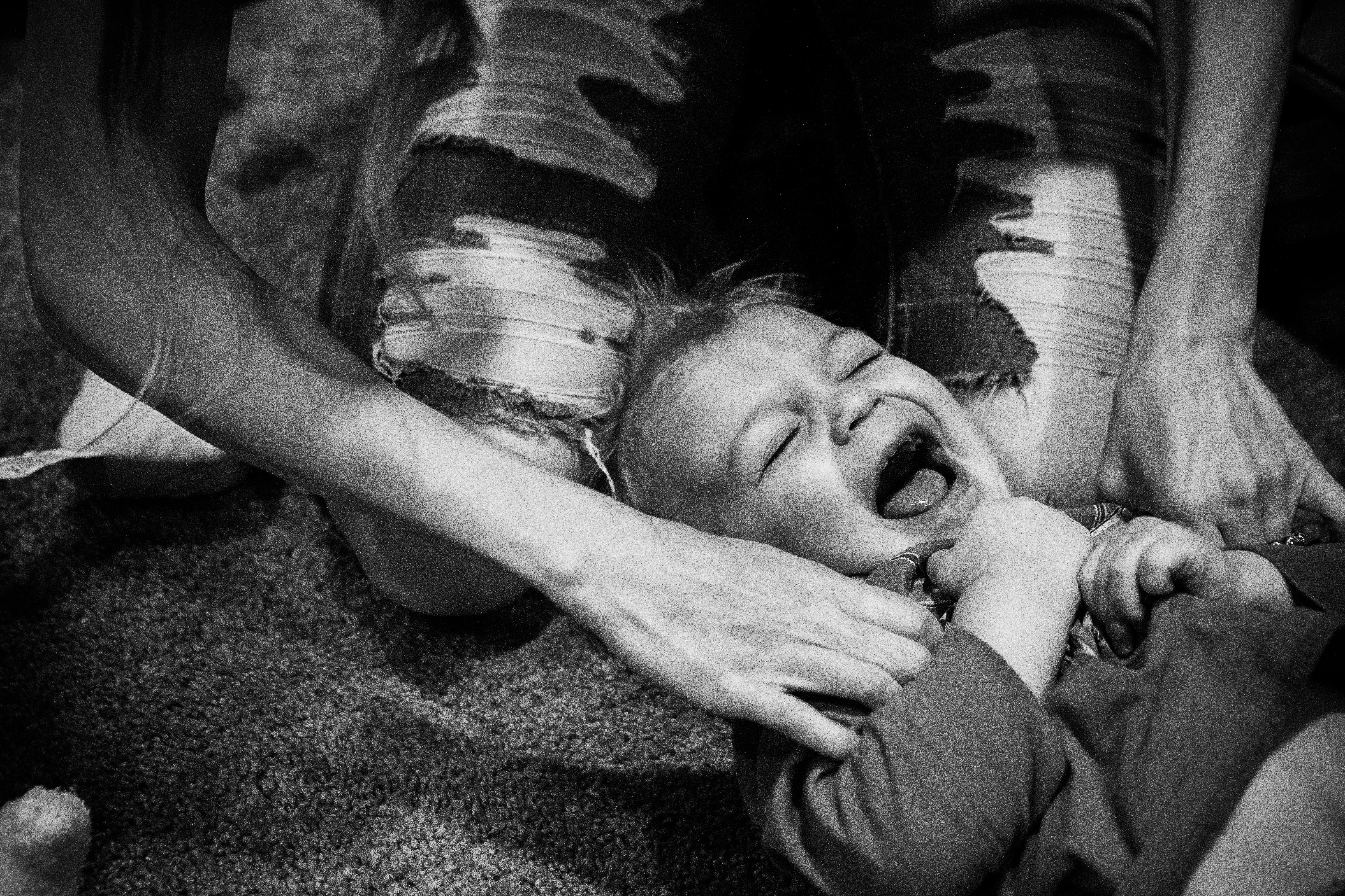 Mom tickles toddler