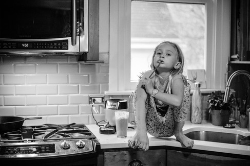Portrait of girl sitting on counter