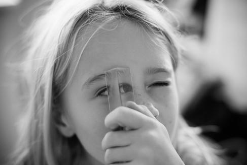 Girl looking through prism