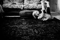 Little girl rolling on carpet