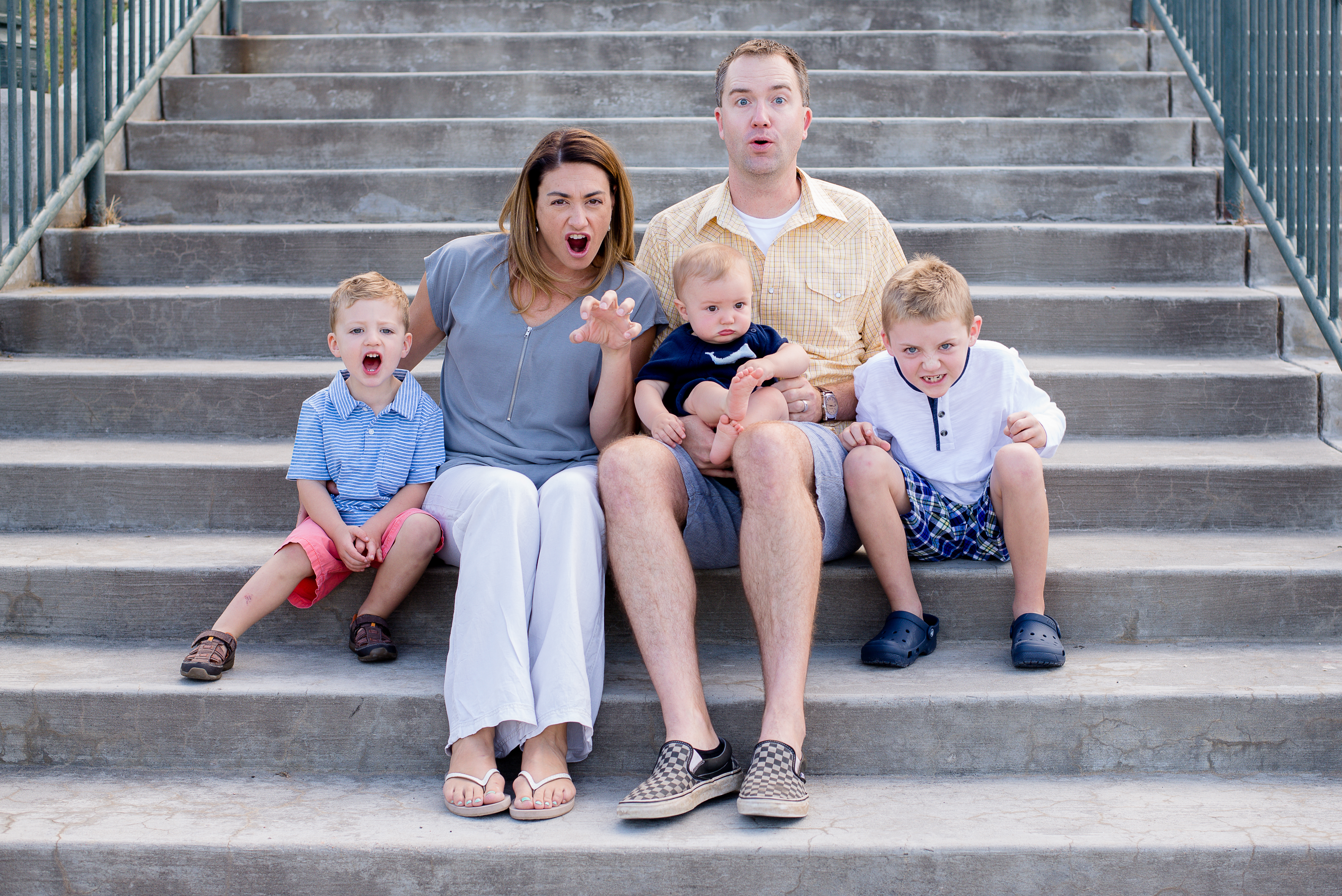 Young family growling on stairs