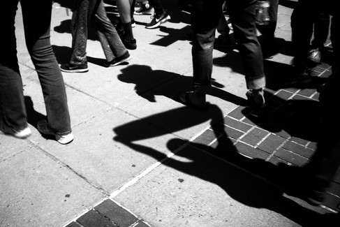 Shadows of people holding protest signs