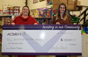 WBFBA's Arianna Johnson accepting donation cheque from Acden's Michelle Drummond.