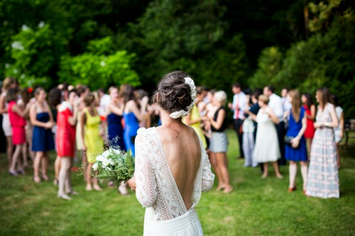 Bride getting ready to throw her wedding bouquet to her friends