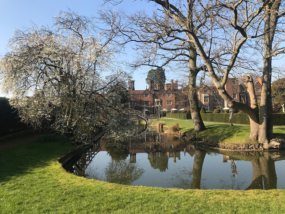 View over the moat at Great Fosters wedding venue Surrey