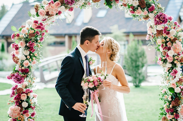 The bride and groom kissing. Newlyweds w