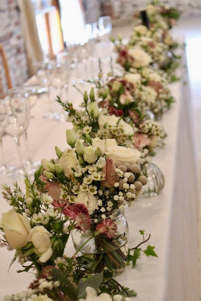 Pastel floral table decoration at wedding reception