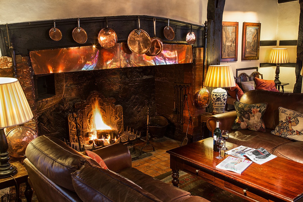 Roaring fire in beautiful fireplace in Spread Eagle Hotel & Spa Midhurst Sussex wedding venue