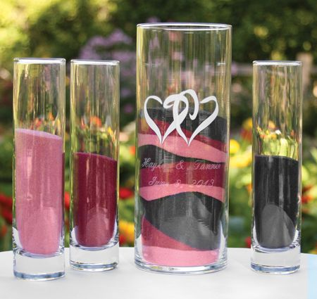 Individual glasses of coloured sand and central large glass with sand combined