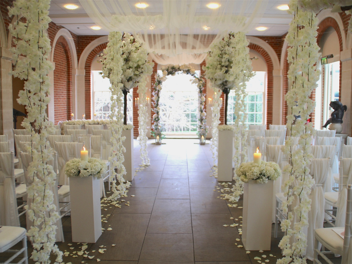 The Orangery at Great Fosters decorated for a spring wedding ceremony
