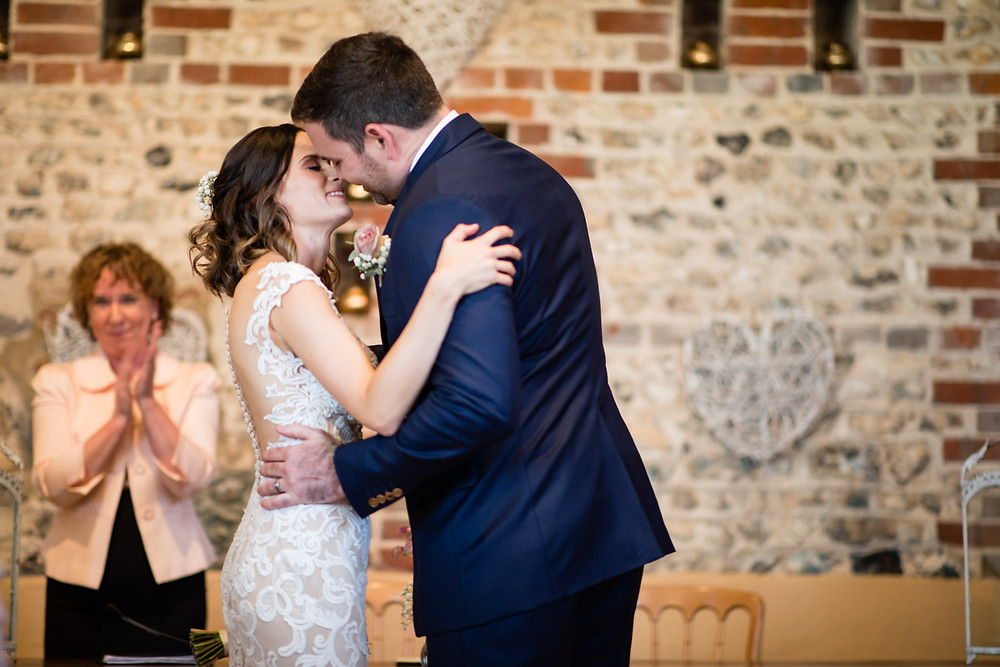 Bride and groom kissing after their celebrant wedding ceremony
